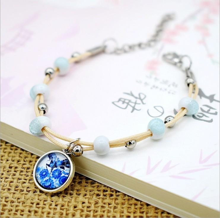 Al por mayor - pulseras de perlas de cerámica de moda pulsera del encanto de 17 estilos para el modelo de la joyería de moda opciones no. NE930-2