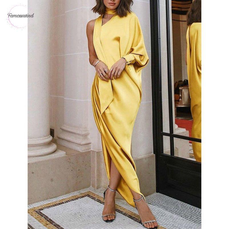 넥 주위에 한 어깨 가을 배트 윙 리본을 입은 옷을 입은 롱 슬리브 디자이너 옷