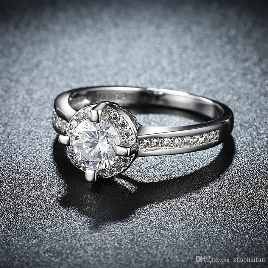 Oro blanco caliente de la venta 18KRGP único circón Anillo de piedra Lleno de boda anillos de compromiso para las mujeres de los hombres