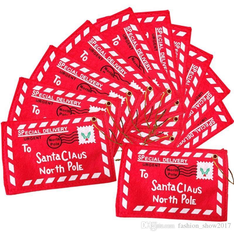 سانتا كلوز عيد الميلاد الأحمر سلموا مغلف قلادة عيد الميلاد الديكور حقائب عيد الميلاد هدايا فتاة مدرسة بطاقات الزفاف اكسسوارات للمنزل