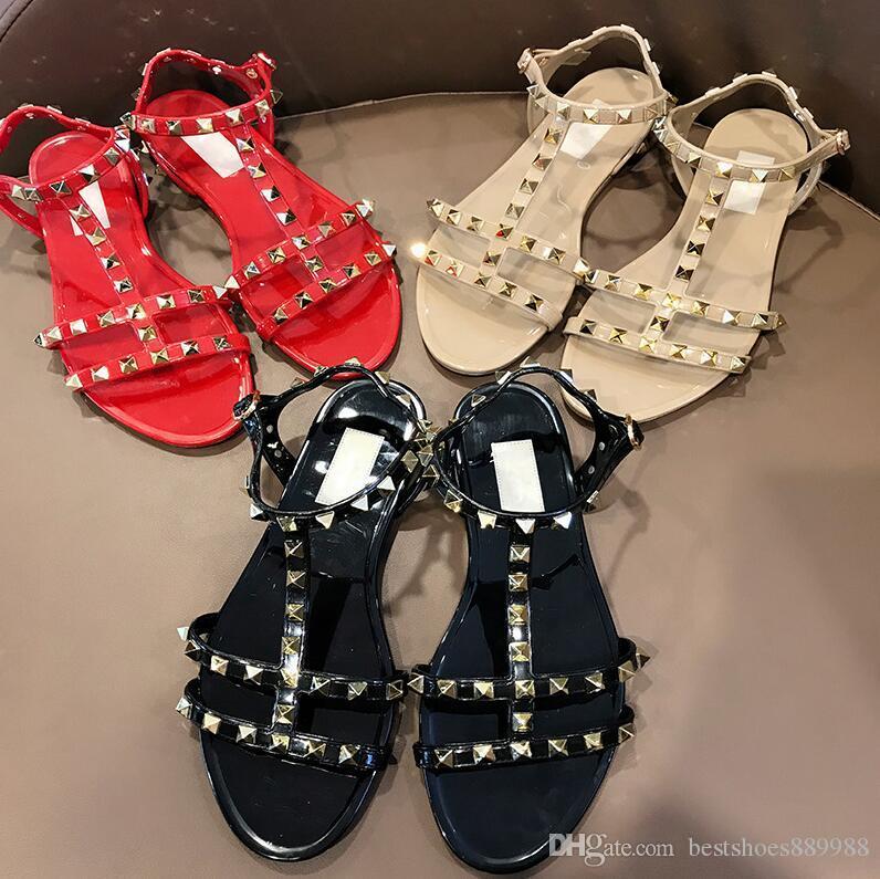 Diseñador de la mujer de moda de lujo de las sandalias de los remaches Bowknot grande playa del verano Sandalias Femininas Sandale plana sandalias de la jalea tamaño 35-40