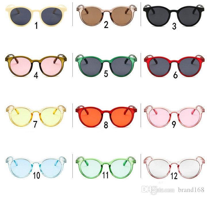 (ÇİN'DE YAPILDI) Ücretsiz Kargo 12 Renkler Yeni Klasik metal Yuvarlak güneş gözlüğü unisex spor güneş gözlüğü Açık bisiklet güneş gözlükleri.