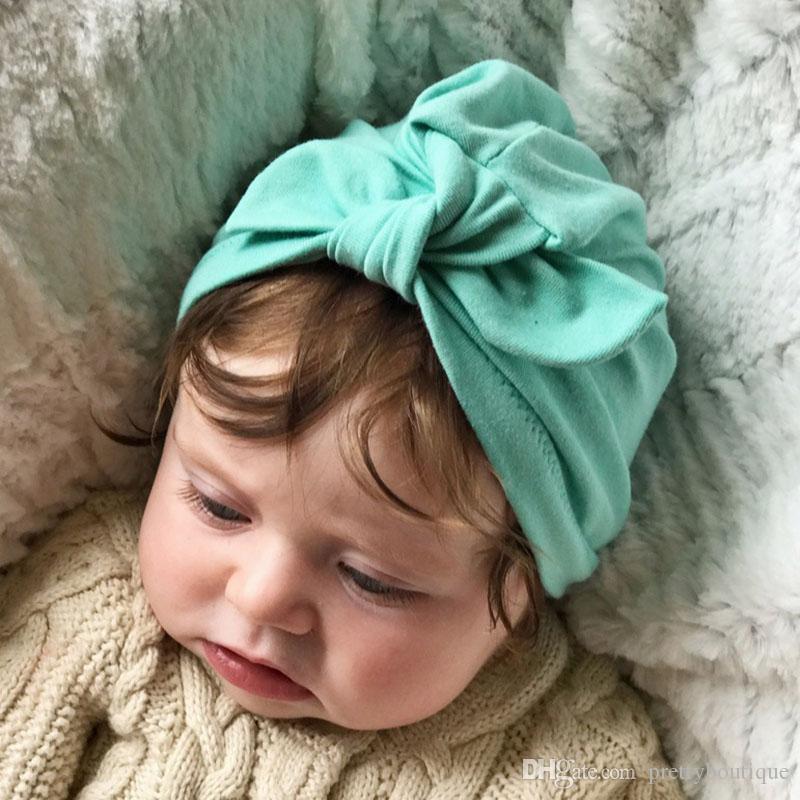 Neonata cappello del cotone Bow Newborn Infant solido di colore della caramella Beanie Caps accessori Bambina Bambino Capelli H20