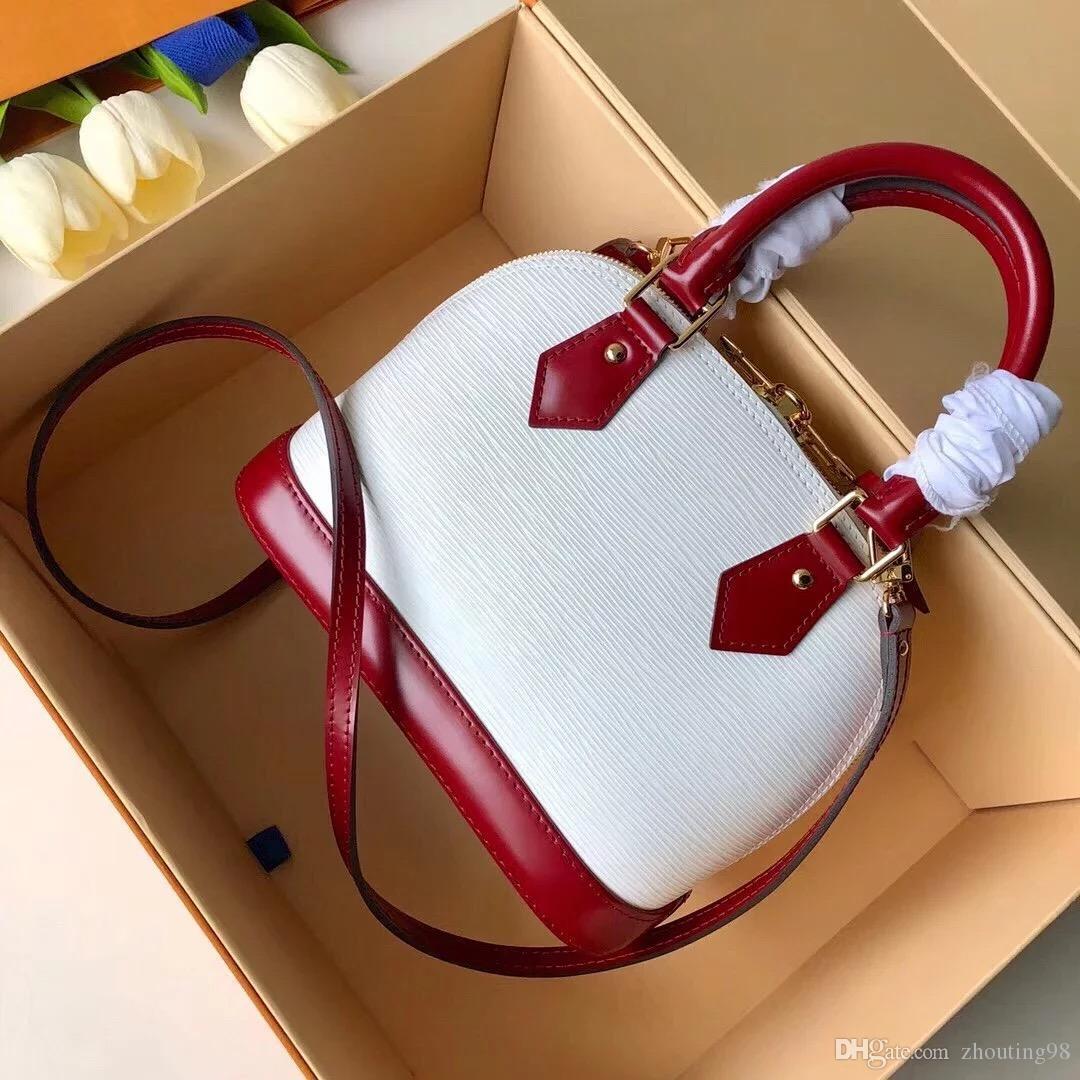 Бесплатная доставка!!!19ss AAAAAAA журнал стиль оболочки воды рябь ручка eather сумки, мода старинные натуральная кожа цепи мешок Deesigner сумки