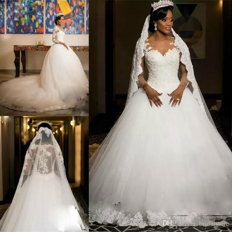 Robe de mariée africaine en dentelle robes de mariée Vintage Appliques Illusion manches longues, plus la taille robes de mariée cathédrale train Tulle robe de soirée