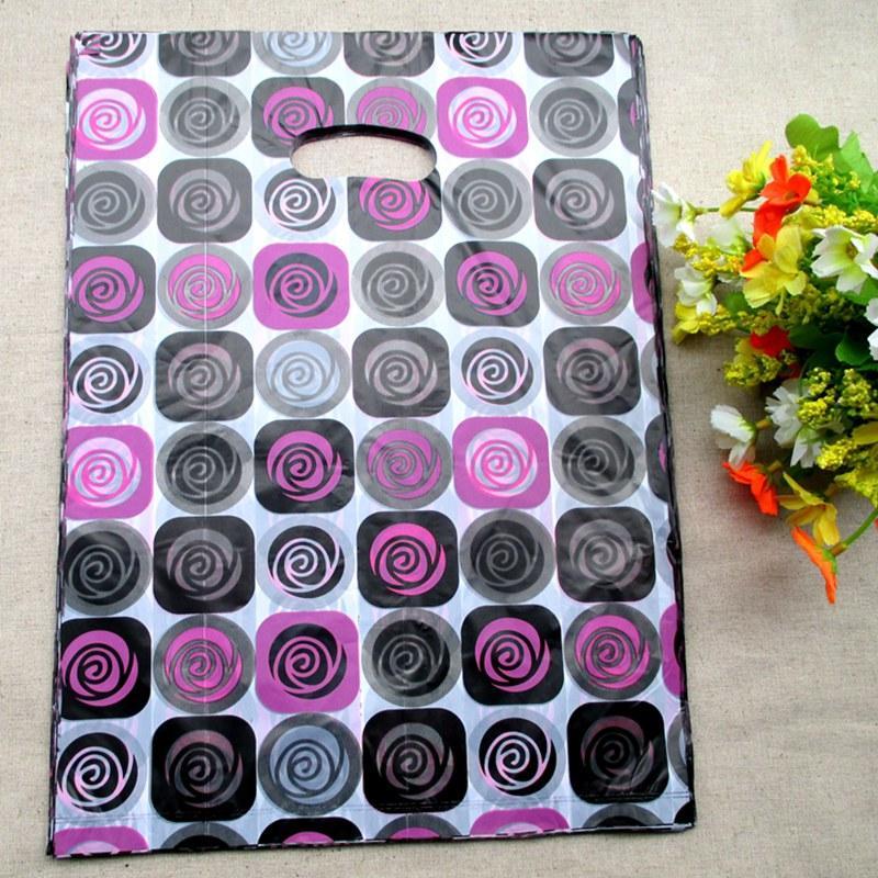 20 * 15cm roses conçoit des sacs cadeaux Pochettes en plastique Paquet cadeau Sac shopping Fleur Sacs Party Supplies cadeaux