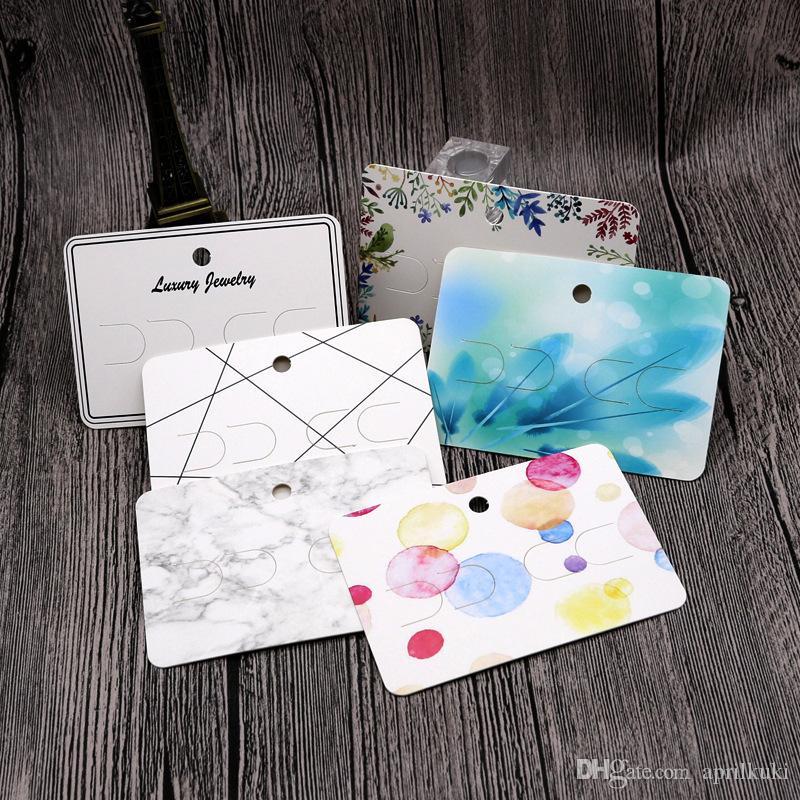 نوع جديد مطبوعة البسيطة جميل الأذن كليب التعبئة بطاقة 100pcs التي / الكثير 7x10cm بطاقة أقراط بالجملة يمكن شعار مخصص