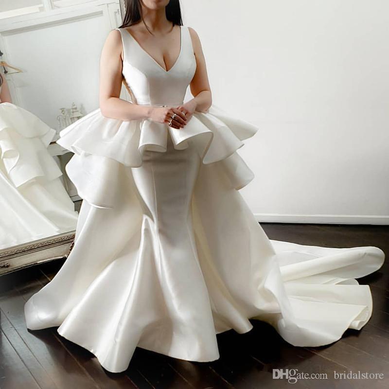 Dubai Elfenbein Meerjungfrau Brautkleider mit Übersprünge Abnehmbarer Zug Sexy V-ausschnitt Satin Peplumn Country Hochzeit Brautkleider Gartenkleidung 2020