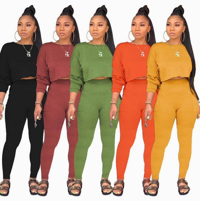 alrededor del cuello de la moda de manga larga bolsillo de los pantalones del suéter de las mujeres europeas y americanas colorean el juego de dos piezas sólida