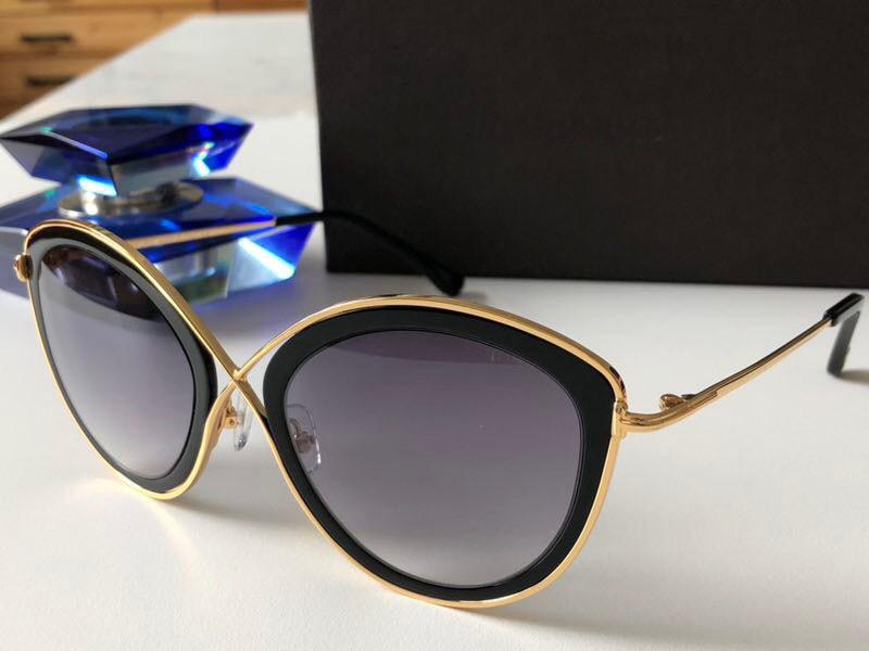 Nuevo diseñador de moda Gafas de sol 0604 Gato Marco de ojo superior Calidad Estilo popular Protección más rápida Eyewear UV 400 Lente con estuche TVNMV