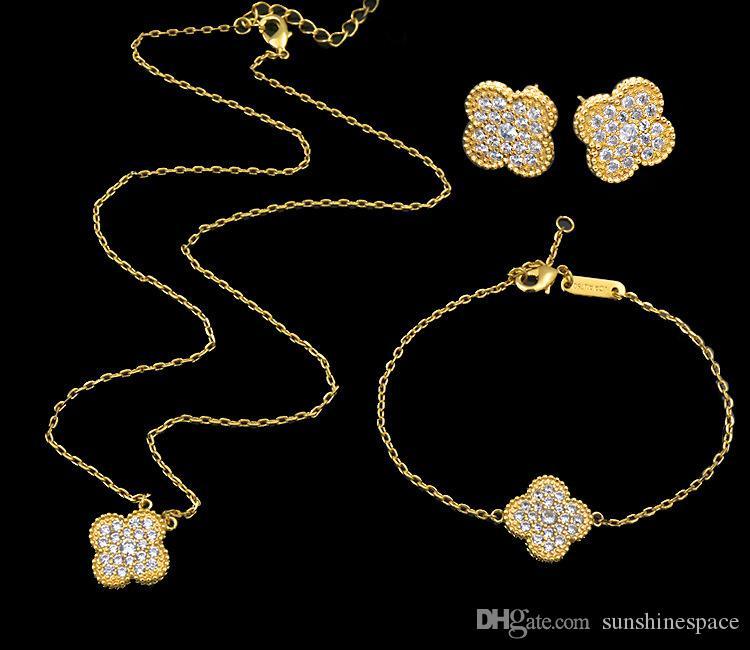 Reine Lotus de haute qualité mode plaqué or 18k Fleurs série Bracelet Boucles d'oreilles Collier Ensemble de bijoux pour les femmes en gros
