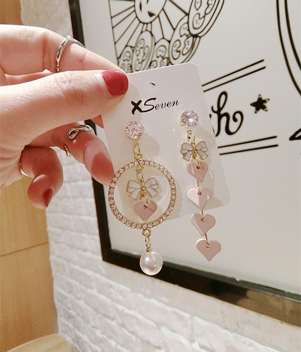 Coreano moda orecchini Pink Love orecchini asimmetrici arco ragazza di origine all'ingrosso