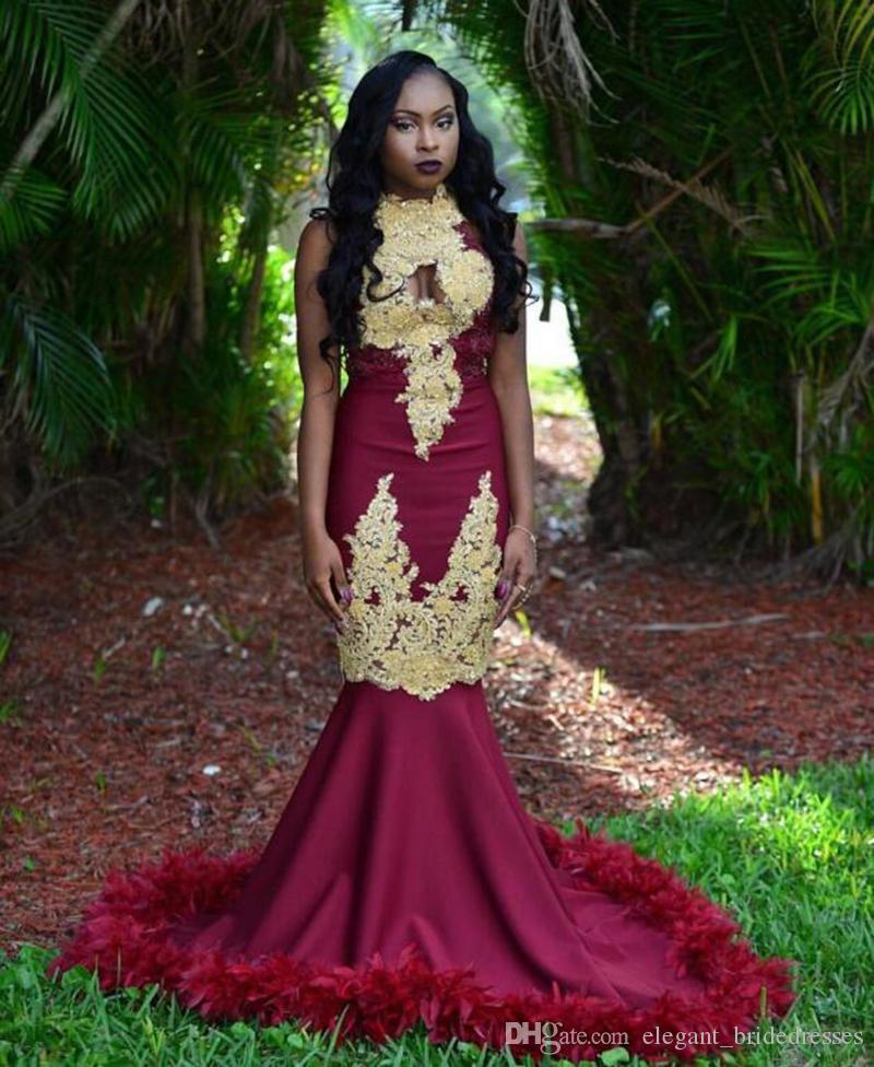 African Black Girl Burgundy Mermaid Prom Dress 2019 Stunning Beaded Gold Lace High Neck Feathers Backless Long Graduation Dresses