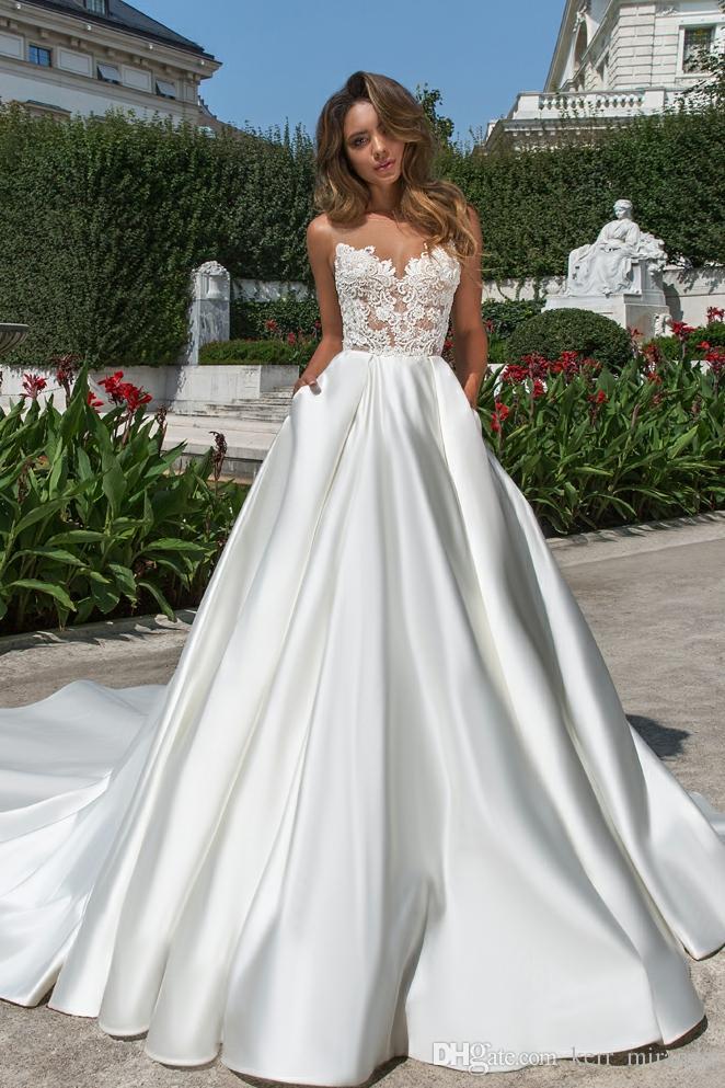 2020 Neueste heiße Verkaufs-Spitze Brautkleider A-Linie Appliques Sleeveless Sweep Zug Brautkleider Plus Size Strand Satin Brautkleid