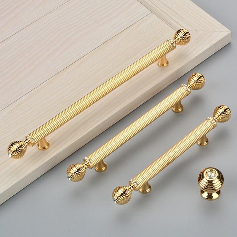 Perillas y tiradores de cristal de lujo de la puerta de la cocina de cristal Armario del cajón de oro Perillas del armario Armario Tiradores Tiradores Precio al por mayor