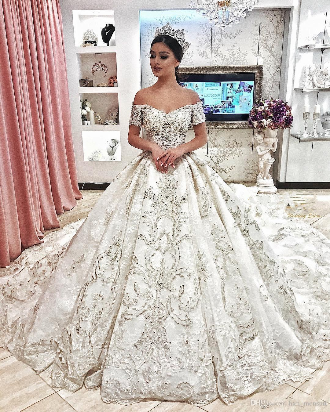 2019 New Dubai Arabic Luxury Sparkly Ivory Wedding Dresses Sexy Bling Beaded Lace Applique Illusion Long Sleeves A Line Chapel Bridal Gowns