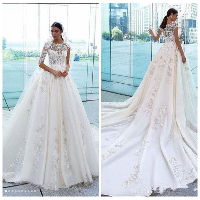 À manches courtes en dentelle A-ligne robes de mariée 2020 Modest Robes de mariée Princesse Garden longue Vestidos De Mariee Taille Plus Manches courtes