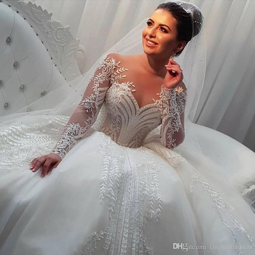 2020 Arabic Long Sleeve Wedding Dresses Sheer Neck Appliques Tulle Beads Bridal Gowns Covered Buttons Ball Gown Wedding Dress Plus Size