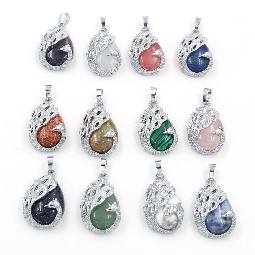 10 piezas en forma de plata al por mayor del pavo real plateado joyería cuarzo de la cereza azul pendiente de arena de piedra Animal Charm