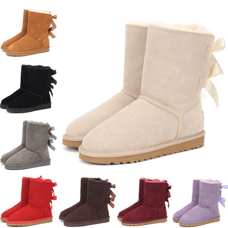 2020 HOT Austrália botas de neve Meninas Estilo Crianças Botão bonito Waterproof Deslizamento-em botas de couro de vaca Crianças de Inverno sapatos de EUR 22-35