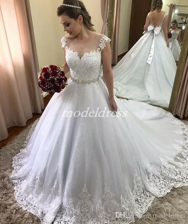 Sparkly White Wedding Dresses Sheer Jewel Neck Backless Sweep Train Appliques Sash Bow Chapel Garden Country Bridal Gowns vestido de novia