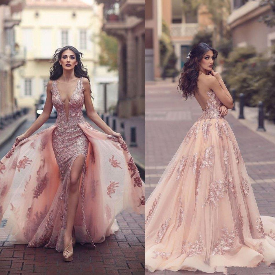 2019 Modest Blush Pink Lace Prom Abiti da spettacolo con treno staccabile Sexy Split con scollo a V Dubai Arabo Princess Occasion Evening Gown