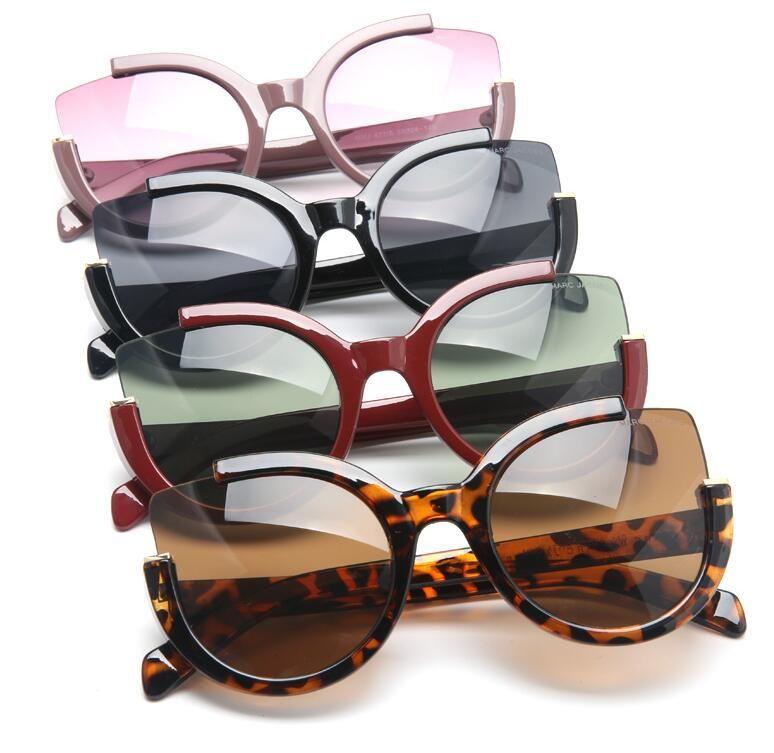 Europäische Straße einzigartige Design-Sonnenbrille Ultrahalb retro Gezeiten Sonnenbrille Katze Augenrahmen weibliche Sonnenbrille Schießen
