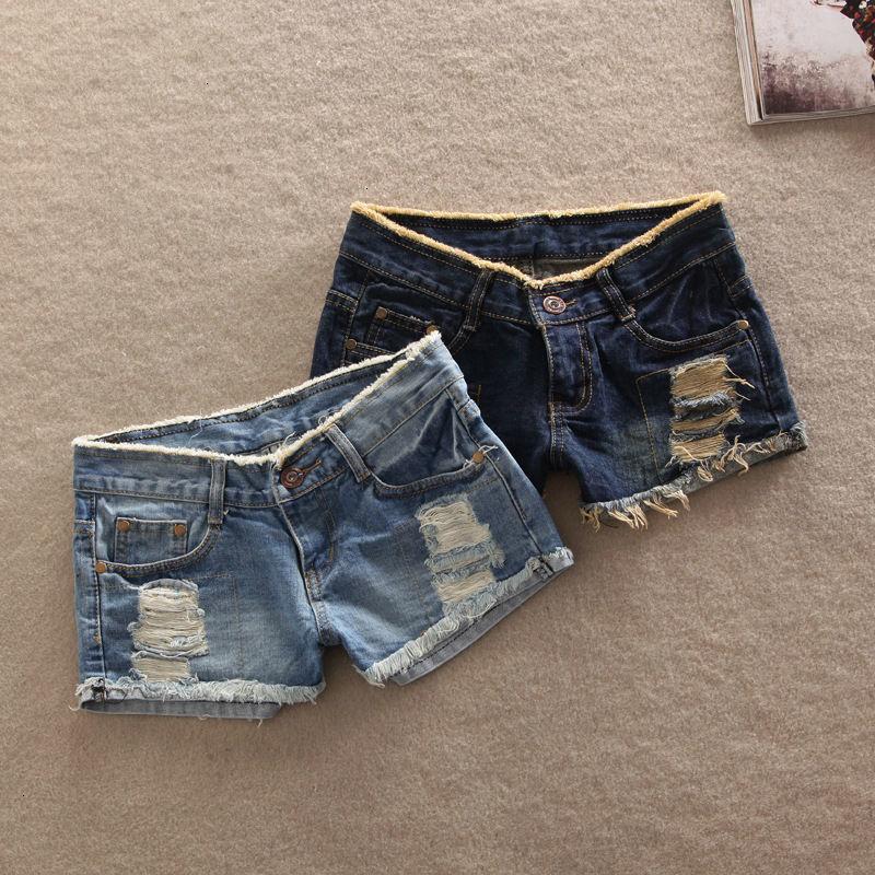 Breve Femme Pantalones cortos para las mujeres calientes 2019 Venta Inicio de las nuevas mujeres atractivas suelta denim pantalones vaqueros del agujero de cintura corta chica Pantalones cortos