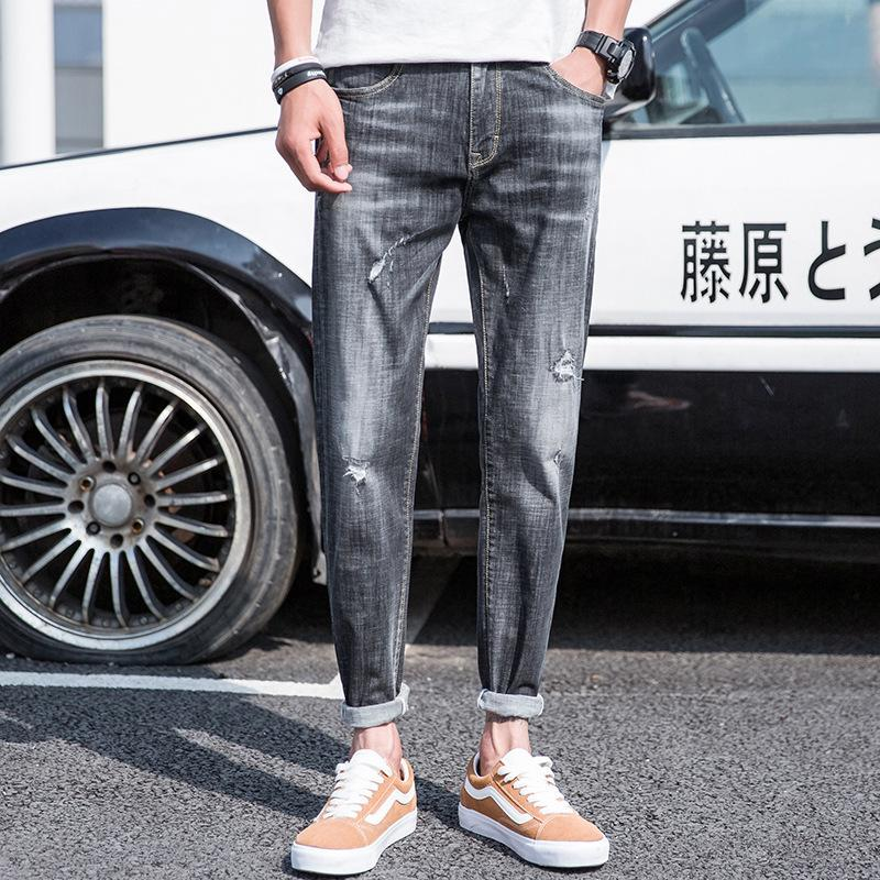 Pop2019 hombre blanco europeo de impresión Vaqueros juveniles de tendencia Directamente del frasco delgado Fuerza Elástica pies atados vaquero Pantalones agujeros Fondo