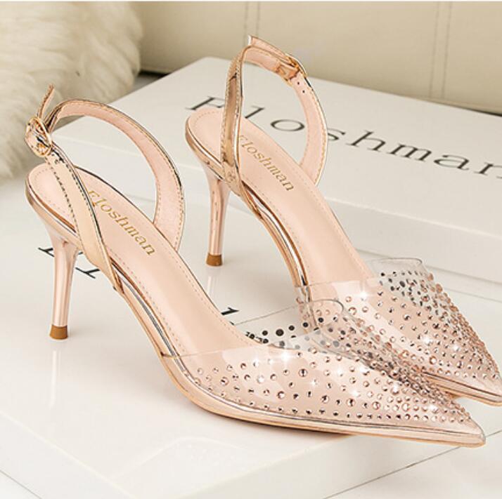 Verano nuevo estilo europeo y americano sencilla de poca profundidad en punta zapatos de tacón alto de las sandalias de moda de perforación de agua transparente con sho de las mujeres ahueca hacia fuera