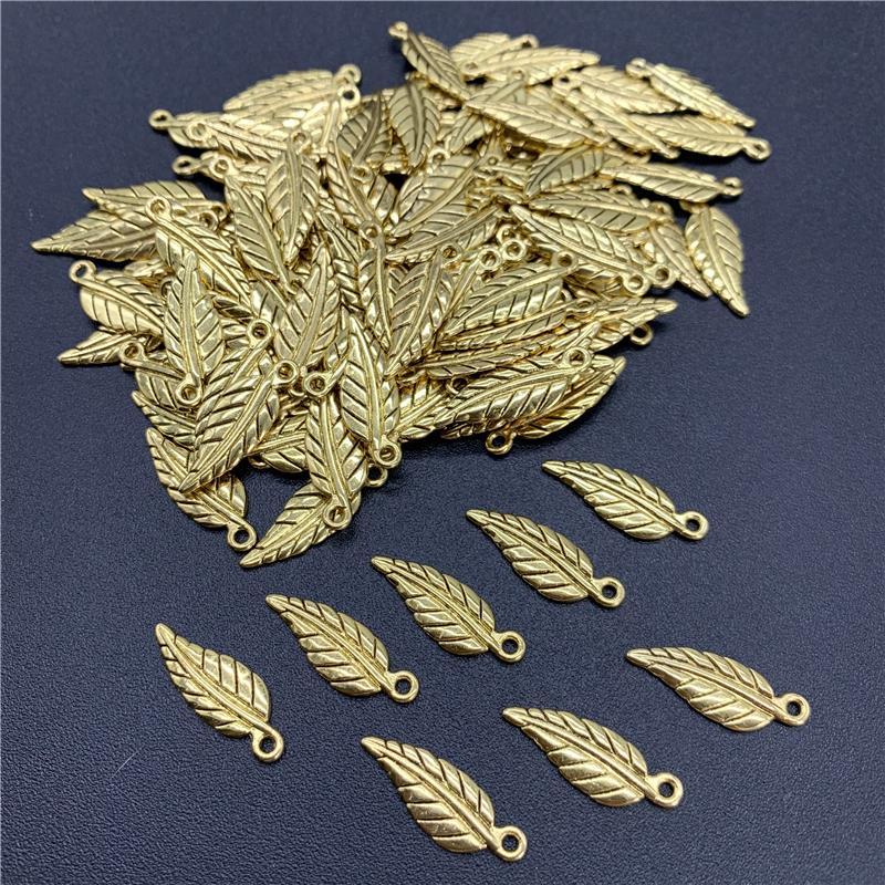 100pcs 20x7mm Alloy Beads Cap d'oro antico Charms figura di fogli di fascini del pendente per monili che fanno accessori fai da te