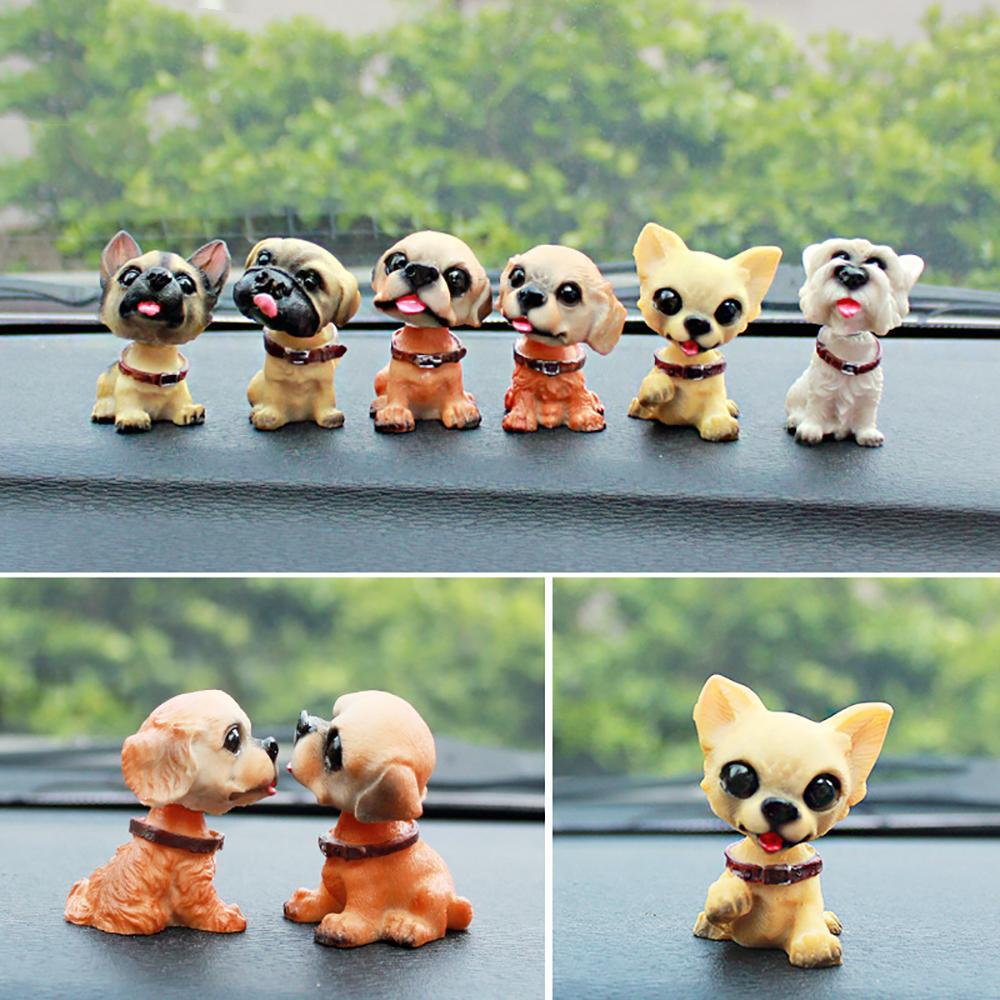 Auto ornamenti 6pcs / lot Nodding Dog Doll bello della resina Shaking Decorazione veicolo capo cucciolo carino Vetture Accessori Interni