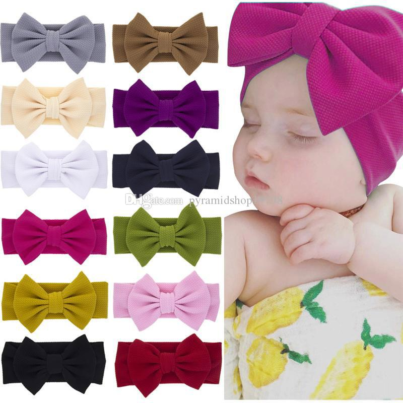 Más nuevos bebés niñas arco grandes cintas para la cabeza Elásticos del Bowknot hairbands sombreros tocado de la cabeza bandas recién nacido cabeza del turbante envuelve