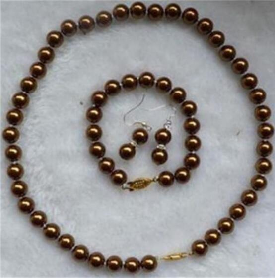 L'orecchino commovente stabilito dell'orecchino dei braccialetti della collana della perla della conchiglia del cioccolato di 8mm che trasporta il trasporto libero