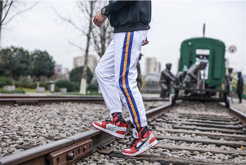 Cordón lápiz pantalones para hombre regular mediados de cintura rayada Impresión Capris pantalones del remiendo del bolsillo de la manera del Mens