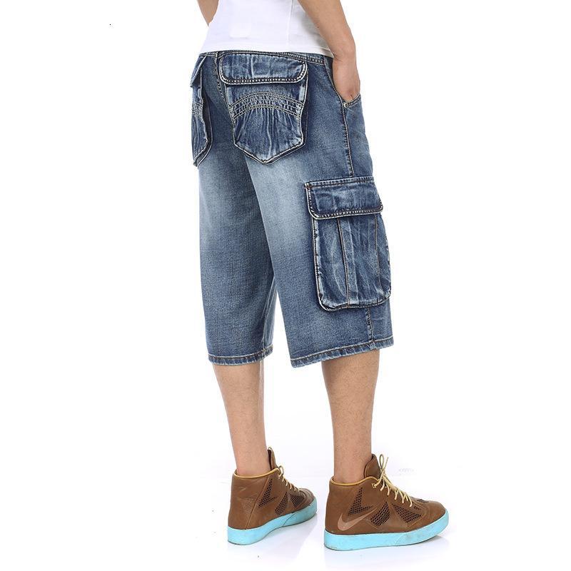 Alta calidad nueva de la manera del verano del Mens Cargos bolsillo de los vaqueros del dril de algodón flojo pantalones anchos pantalones vaquero cortocircuitos más el tamaño 30-46