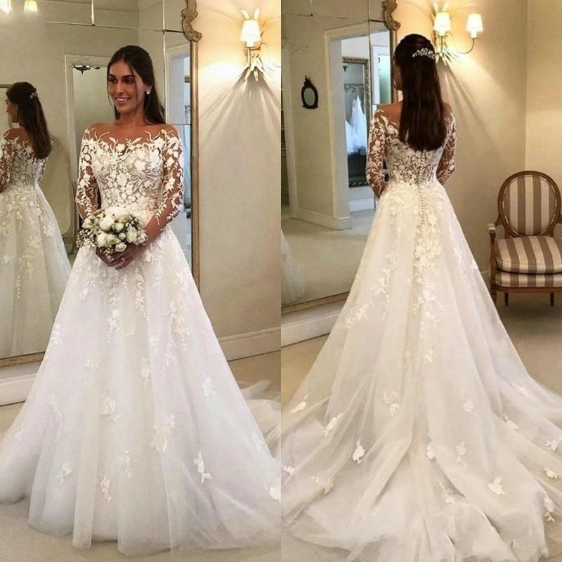 Romantische illusie lange mouwen kant trouwjurken bedekt knop sweep trein tulle a line bruid jurken applicaties