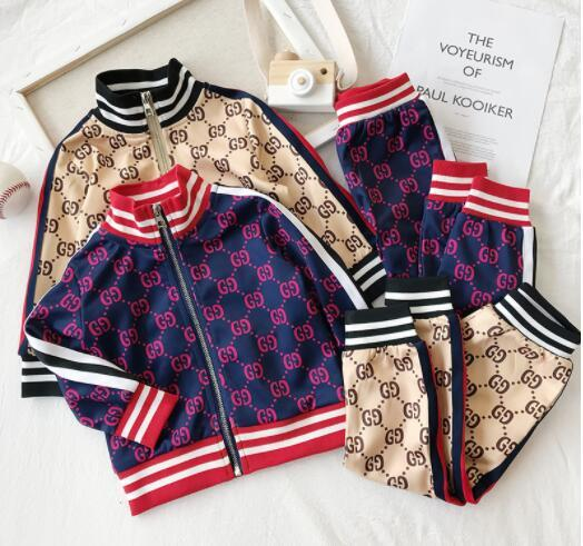 Primavera nueva ropa deportiva casual hombres y mujeres bebé moda infantil cruz color carta de dos piezas chaqueta de punto