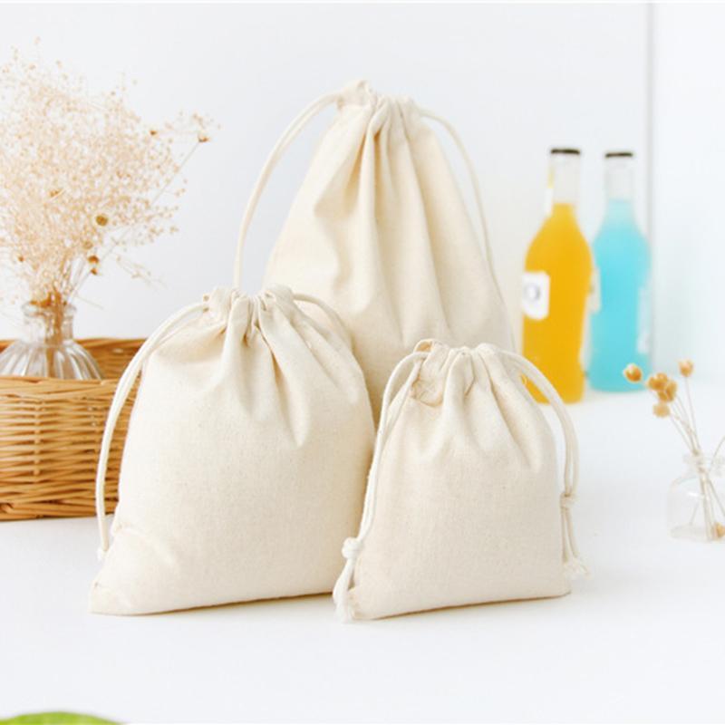 Viajes bricolaje algodón de lino con cordón de las misceláneas de almacenamiento de pequeño haz de cuerda hecha a mano bolsas caramelo bolsa de regalo de los cabritos juega al organizador