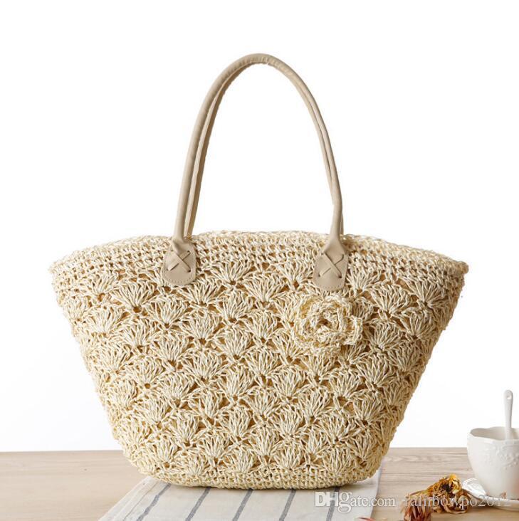 La borsa all'ingrosso delle donne della borsa del commercio all'ingrosso ha intagliato il sacchetto di paglia delle coperture borsa di spiaggia fragile all'uncinetto del merletto estate nuova borsa a foglie rampanti stereo