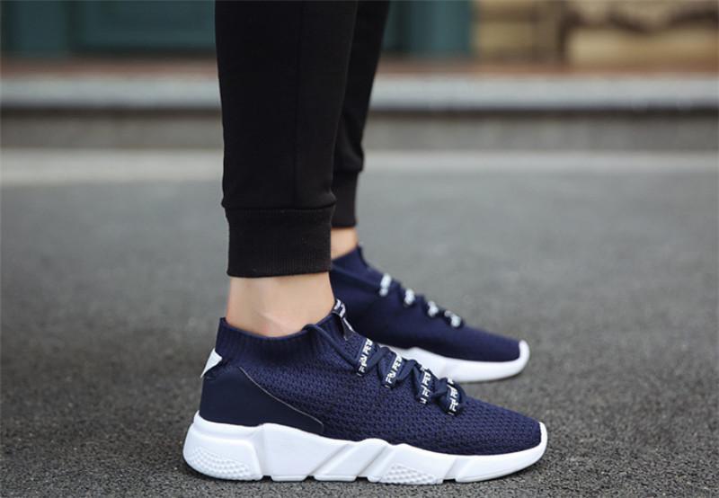 الجملة ذات جودة عالية الساخن بيع يطير البرية تنفس الشباب Chaussures مصمم أزياء أحذية المدربين أبيض أسود أحذية رياضية للرجال الاحذية