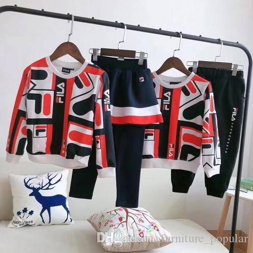 Venda quente das meninas do outono e Boy Fashion algodão 2pc Ternos do bebê Roupa Define Crianças Thirt Impressão bonito e Pant Pant saia Sets