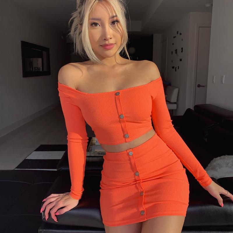 النساء 2PCS فساتين الربيع فستان مثير سليم مع زر عارضة لون الحلوى أنثى الملابس القطع الرقبة