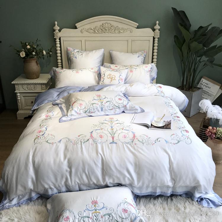 GRANDE !!!! SELE estilo europeo de lujo 100 Tencel princesa encaje color crema bordado cama determinada de rey reina funda nórdica cama falda fundas de almohada