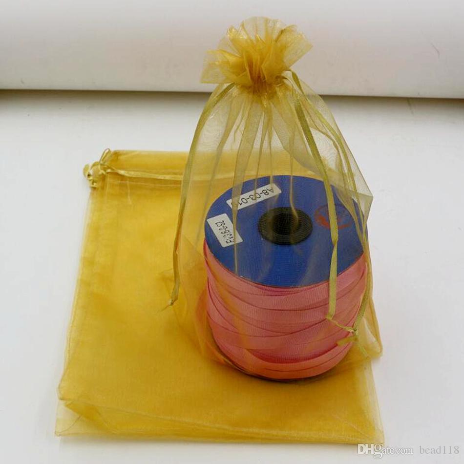 المبيعات الساخنة! 100pcs ذهبية اللون أكياس الأورجانزا هدية ، 7x9cm. 9x11cm. 13 × 18 سم .17 × 23 سم. 20x30cm مع الرباط