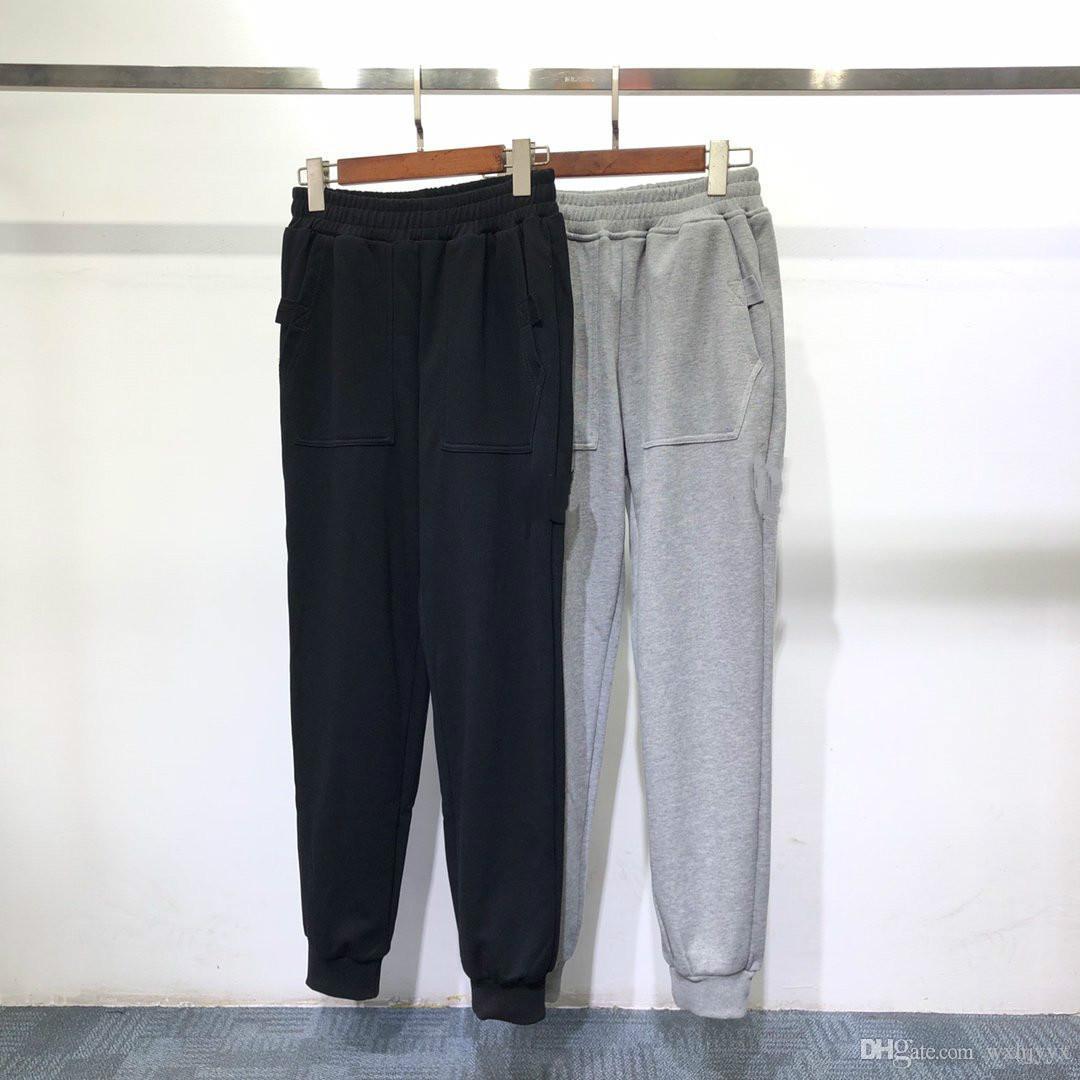 2020 Europe et Amérique de nouveaux pantalons de mode sport hommes pantalon étiquette bouton broderie alphabet pieds de coton en vrac pantalons de marque Side