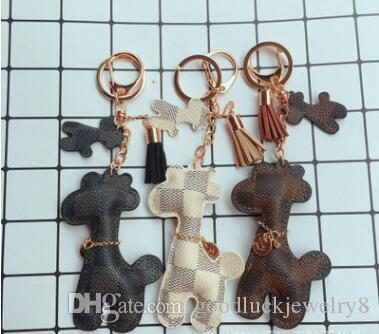 2 piezas / 3 colores de la jirafa llavero llavero Accesorios borla PU de la jirafa Llavero del modelo de coche joyería del encanto del bolso
