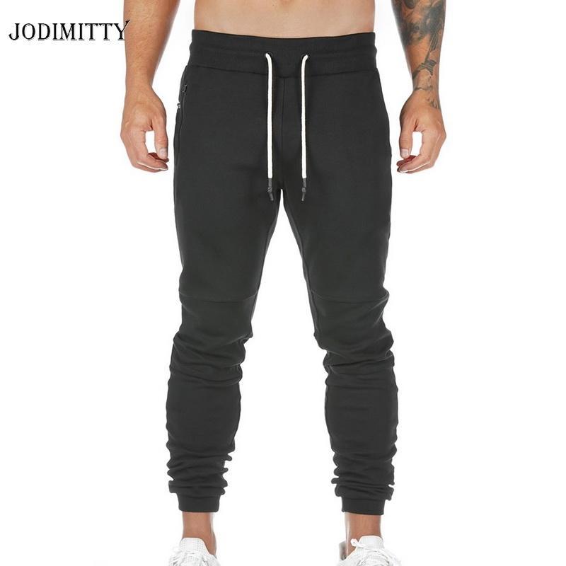 Pantaloni slim fit Zipper Jodimitty nuovi uomini di 2020 Chiusura fondo chiuso Jogger Pantaloni Figura intera Soild di moda pantaloni della tuta