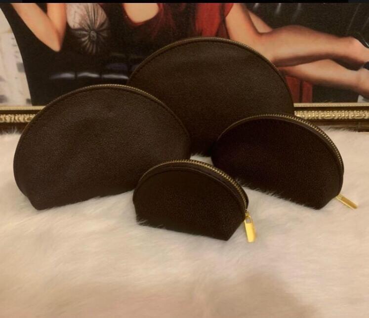 бесплатная доставка 4 шт. / компл. женские косметические сумки известный макияж Сумка дорожная сумка макияж сумка дамы клатчи кошельки туалетные принадлежности сумка