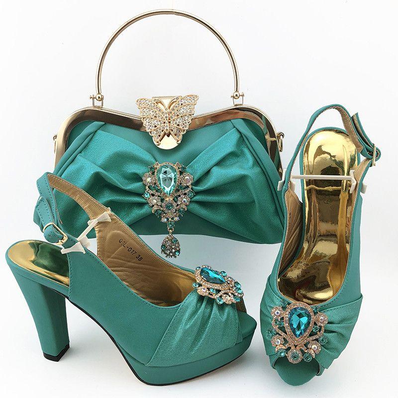 Hermosas mujeres de color azul cielo bombas conjunto bolso de juego con la decoración de cristal de zapatos de vestir de tacón alto y bolso QSL017 africanos, 11 cm talón